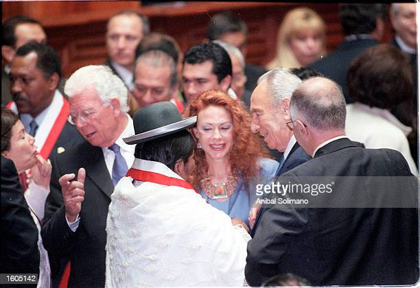 Israeli Foreign Minister Shimon Peres right Peruvian First Lady Elian Karp and congress woman Paulina Arpasi left mingle during a break at Peruvian...
