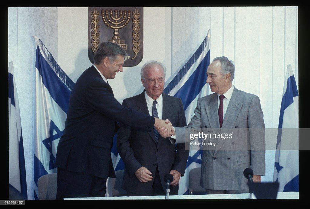 Israeli Foreign Minister Shimon Peres shakes hands with Norwegian Foreign Minister Johan Jorgen Holst at the signing of the peace agreement between Israel and the Palestine Liberation Organization (PLO). Peres, Prime Minister Yitzhak Rabin (center), and PLO leader Yasser Arafat all went on to win the Nobel Peace Prize for signing the agreement.