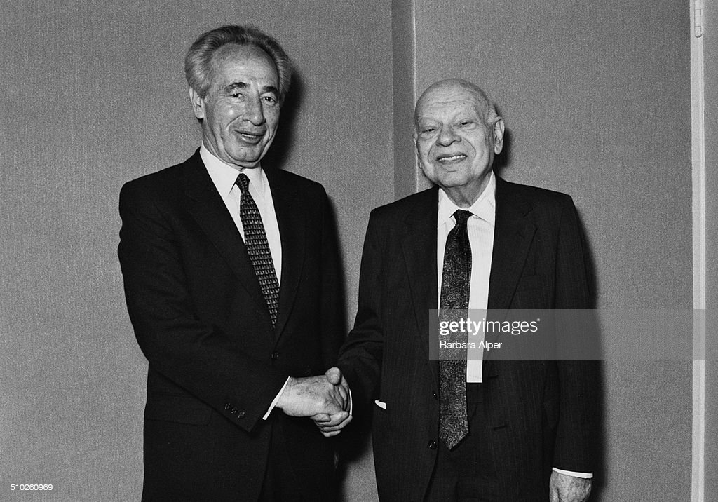 Israeli Foreign Minister <a gi-track='captionPersonalityLinkClicked' href=/galleries/search?phrase=Shimon+Peres&family=editorial&specificpeople=201775 ng-click='$event.stopPropagation()'>Shimon Peres</a> (left) shaking hands with Mr Merkin, 19th May 1988.