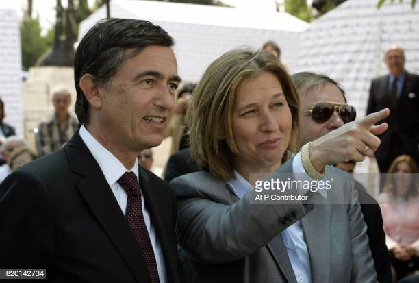 Israeli Foreign Minister Tzipi Livni gestures as she speaks with French Foreign Minister Philippe DousteBlazy during the inauguration of an...