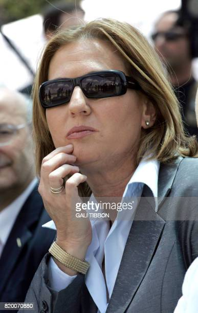 Israeli Foreign Minister Tzipi Livni wears sunglasses as she listens to French Foreign Minister Philippe DousteBlazy during the inauguration of an...