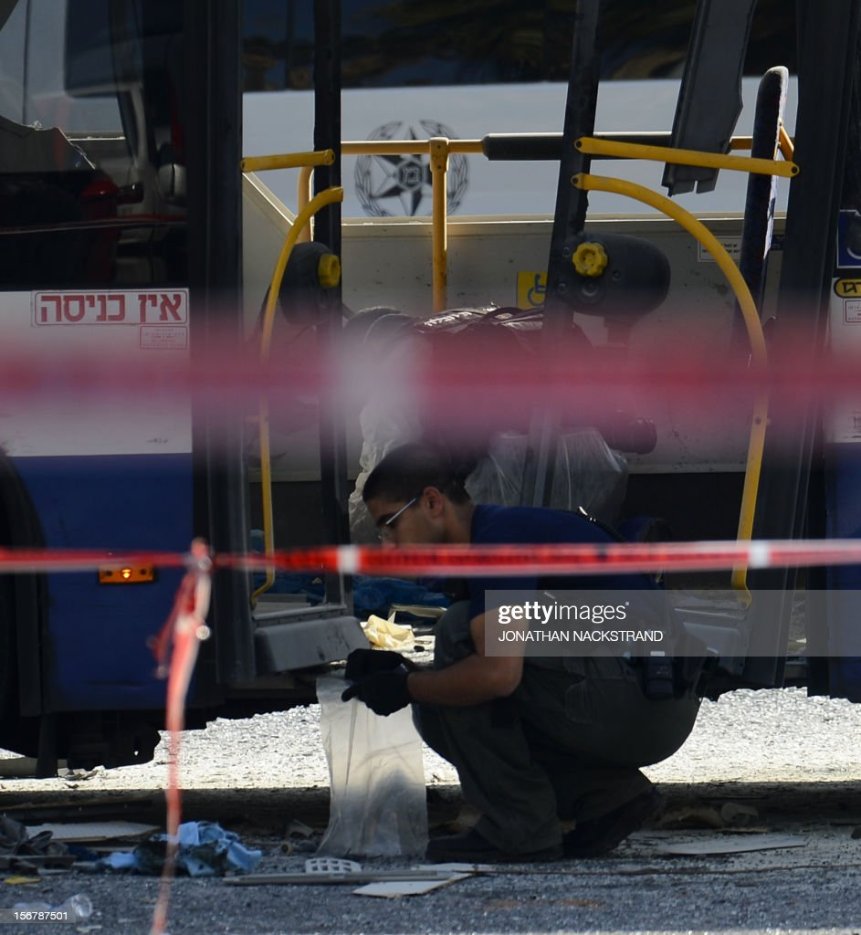 Israeli forensic experts inspect a bus which was hit by a bomb near the defence ministry in Tel Aviv on November 21, 2012. At least 10 people were injured in an explosion on a bus, Israel's emergency services said, in what an official said was 'a terrorist attack.'