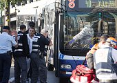 Israeli forensics examine the scene of an attack after a Palestinian man stabbed at least five people on a Tel Aviv bus on January 21 2015 The...