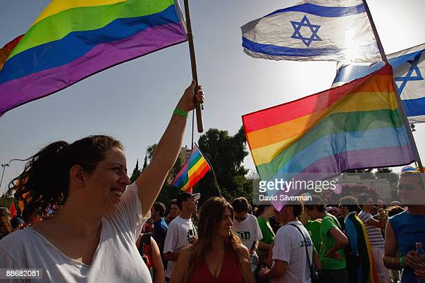 Israeli gays and lesbians wave their flags during the annual Gay Pride parade on June 25 2009 in Jerusalem Israel Thousands of alternative lifestyle...