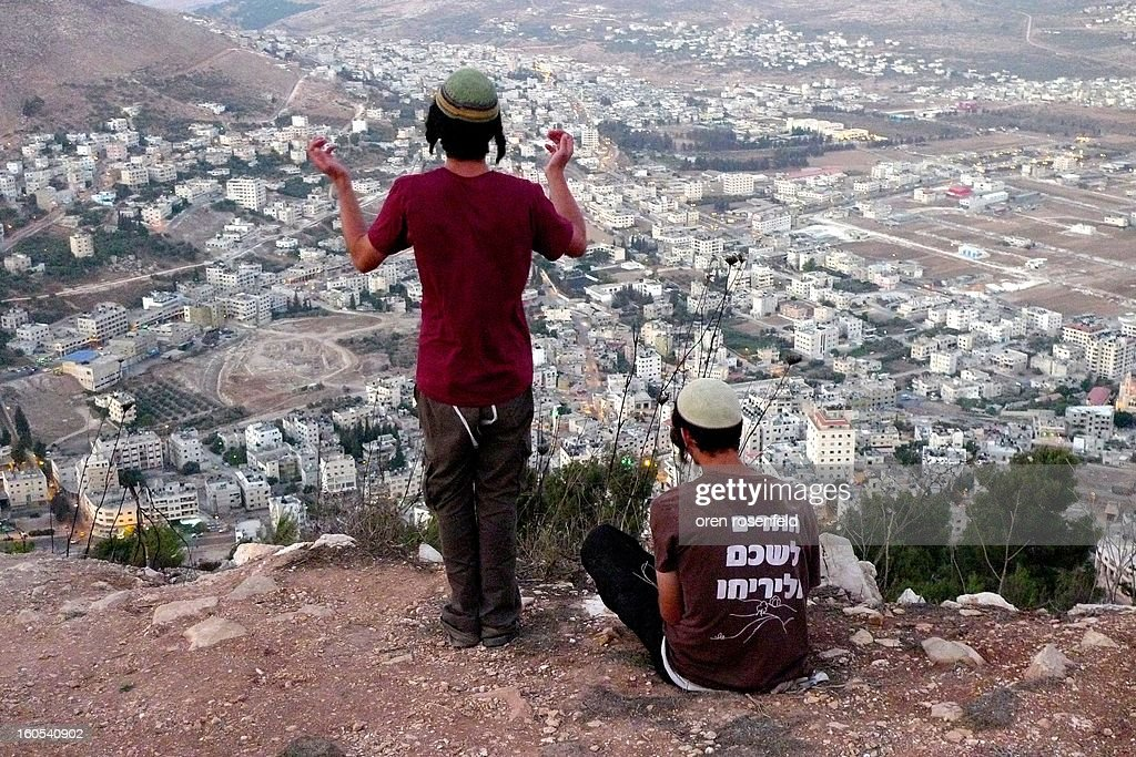 CONTENT] Israeli hilltop youth third generation settlers praying in towards Joseph`s tomb now in area A under Palestinian control.