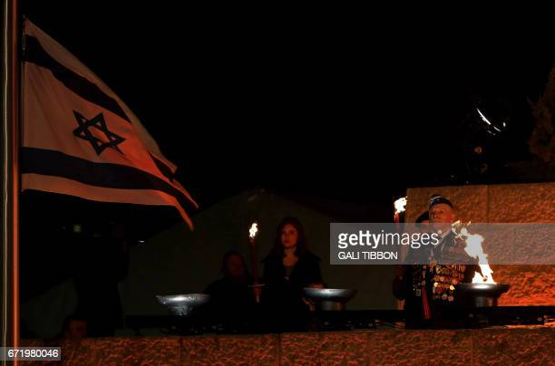 Israeli holocaust survivor Max Privle who was born in 1931 in Mikulichin in Poland waits to light the torch during the state ceremony for Holocaust...
