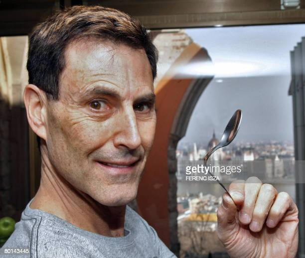 Israeli hypnotizer Uri Geller poses for the press during an interwiew in Budapest on March 6 2008 Geller is on a promotion tour of his new television...