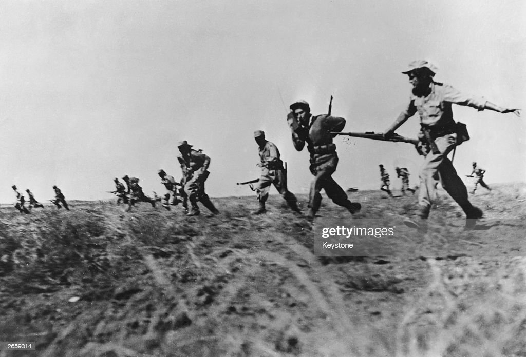 Israeli infantry making a full assault on Egyptian forces in the Negev area of Israel during the War of Independence