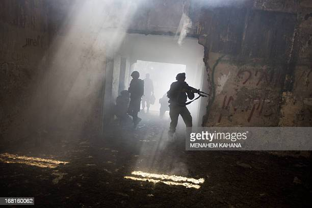 Israeli infantry soldiers of the Golani brigade take part in exercises during their deployment in the Israeli annexed Golan Heights near the border...