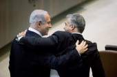 Israeli Israeli Prime Minister Benjamin Netanyahu hugs Yair Lapid leader of the Yesh Atid during a Knesset session on March 18 2013 in Jerusalem...