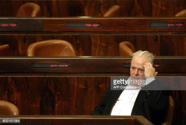 Israeli Justice Minister Tommy Lapid waits at the Israeli Parliament moments before the start of the vote session of Prime Minister Ariel Sharon...