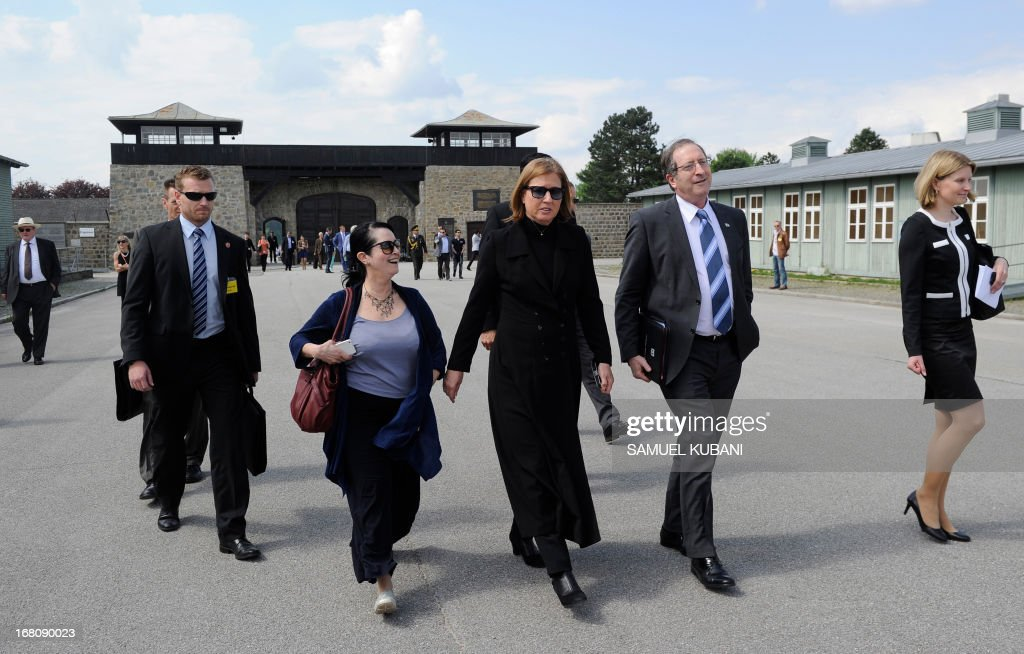 Israeli Justice Minister Tzipi Livni, (C) walks in front of a Second World War monument dedicated to Polish victims of the Nazis, at the former concentration camp Mauthausen, on May 5, 2013. AFP PHOTO/SAMUEL KUBANI