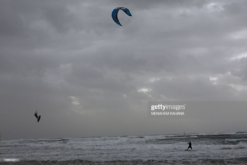 Israeli kite surfers enjoy the stormy weather in the Mediterranean Sea off the coast of Tel Aviv on December 20, 2012.