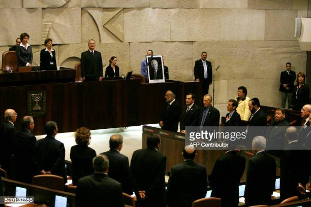 Israeli Knesset Speaker Dalia Yitzik stands with members of the government including Prime Minister Ehud Olmert at the conclusion of a special...