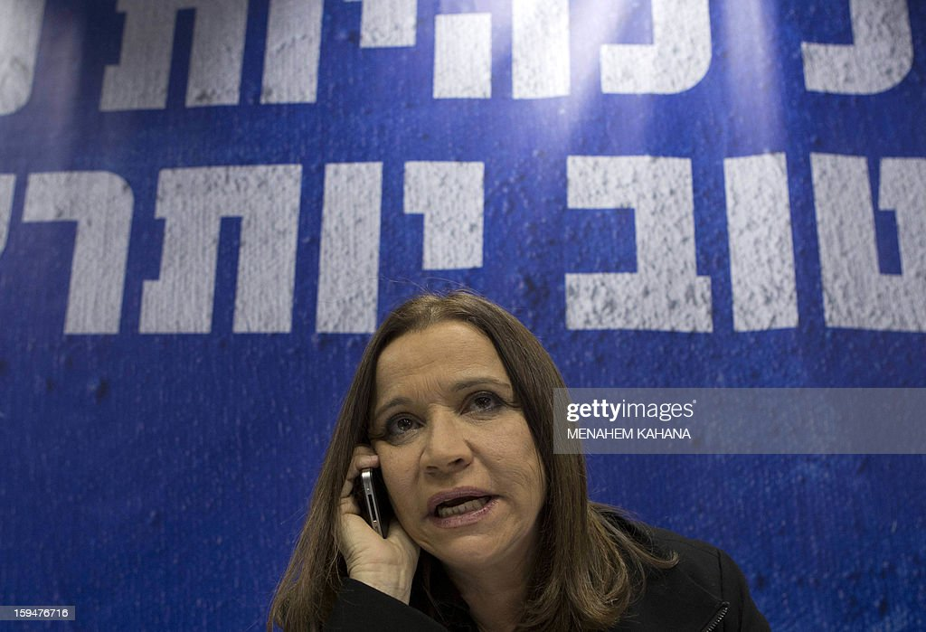 Israeli Labor party leader Shelly Yachimovich calling supporters during campaigning, ahead of the January 22 general election, at a shopping mall in Tel Aviv on January 14, 2013.