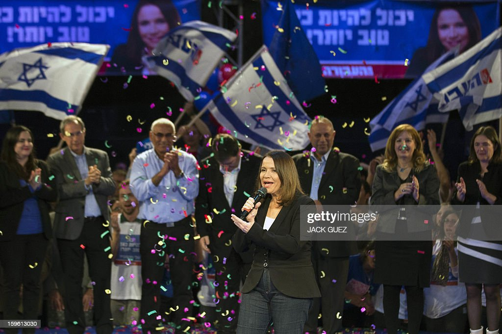 Israeli Labor party, leader Shelly Yachimovich gives a speech during a campaign meeting in the Mediterranean coastal city of Tel Aviv on January 17, 2013. Now headed by Shelly Yachimovich, the party has a strong social justice agenda and polls suggest it would come second with around 17 seats. AFP PHOTO / JACK GUEZ