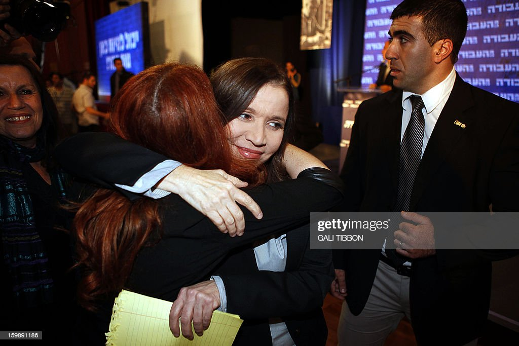 Israeli Labor party leader Shelly Yachimovich (R) is greeted by a supporter early on January 23, 2013 at the party's headquarters in Kfar Saba, central Israel. Israeli Prime Minister Benjamin Netanyahu said it was necessary to form the 'broadest possible government' after his Likud-Beitenu list won a narrow election victory, with the centrist Yesh Atid in second place. AFP PHOTO/GALI TIBBON