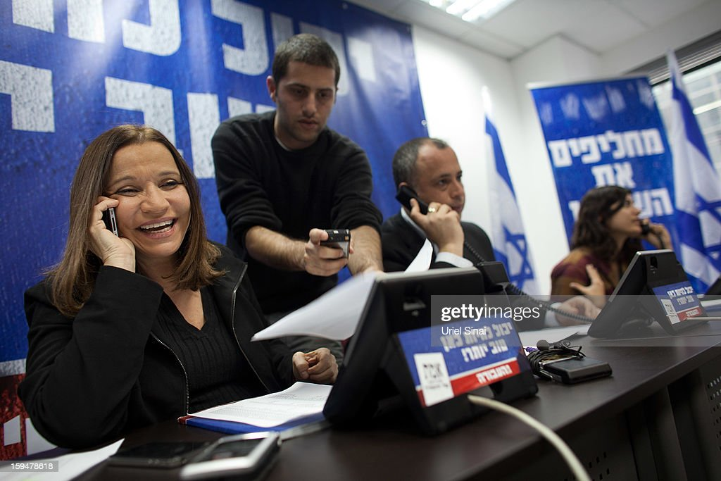 Israeli Labor party leader Shelly Yachimovich speaks on the phone with potential voters ahead of the upcoming Israeli elections on January 14, 2013. in Tel Aviv, Israel. Israeli elections are scheduled for January 22 and so far showing a majority for the Israeli right.