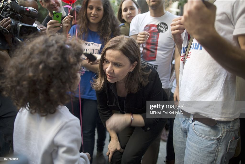 Israeli Labor party leader Shelly Yachimovich speaks to a child during her campaigning in Tel Aviv on January 20, 2013, ahead of the upcoming Israeli elections in two days time. Figures published in the last opinion polls before the election show the joint electoral list of Prime Minister Benjamin Netanyahu's rightwing Likud and the hardline nationalist Yisrael Beitenu losing support. AFP PHOTO/MENAHEM KAHANA