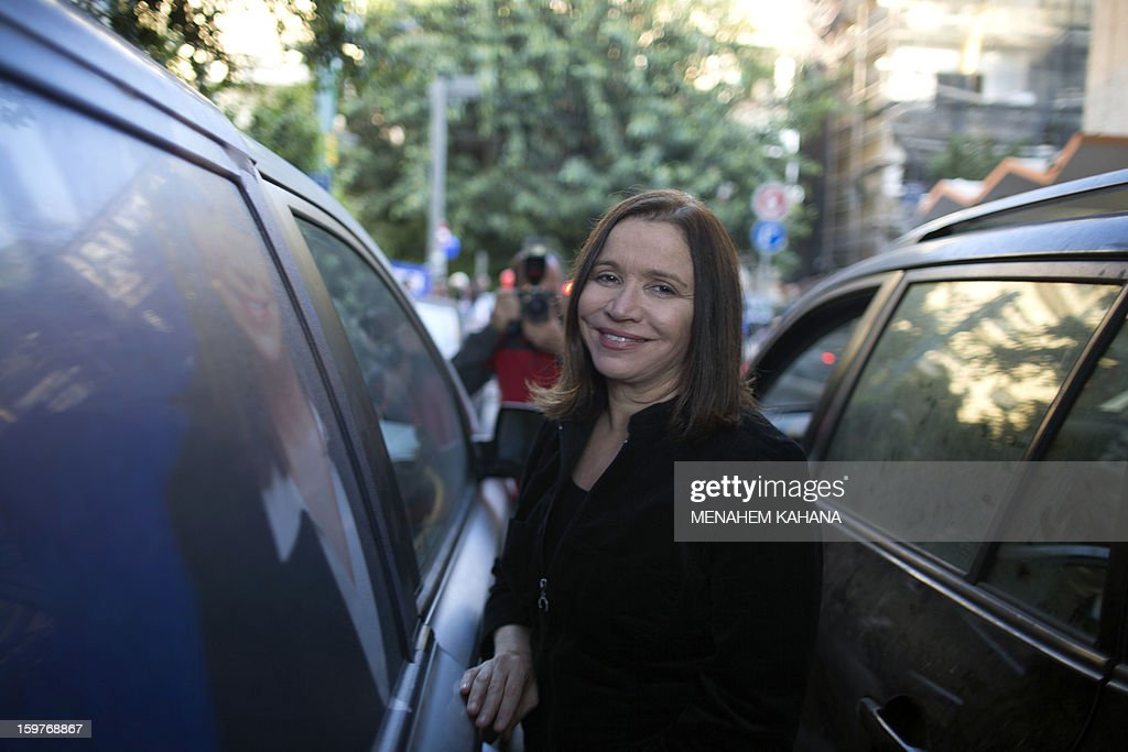 Israeli Labor party leader Shelly Yachimovich stands next to a vehicle during a campaign rally in Tel Aviv on January 20, 2013, ahead of the upcoming Israeli elections in two days time.