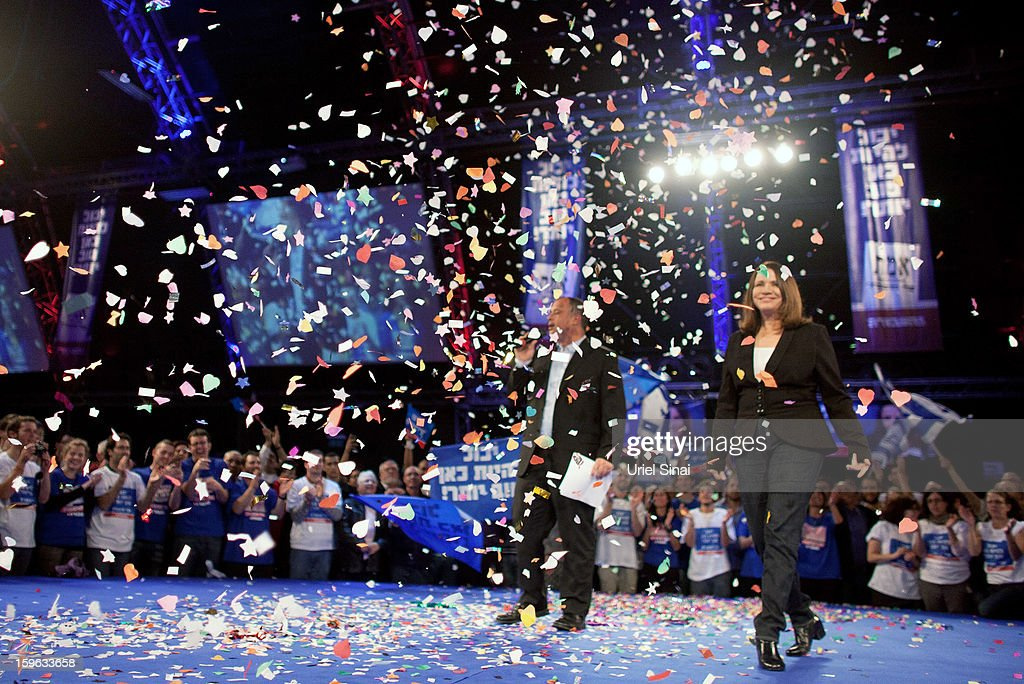 Israeli Labor party leader Shelly Yachimovich (R) walks onstage during a campaign rally ahead of the upcoming Israeli elections on January 17, 2013 in Tel Aviv, Israel. Israeli elections are scheduled for January 22, and are reportedly showing a majority for the Israeli right.
