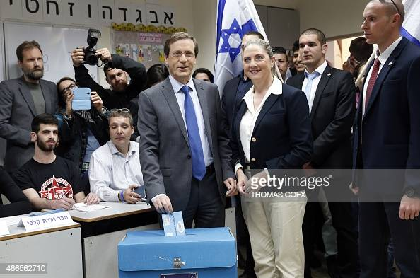 Israeli Labour Party leader and coleader of the Zionist Union list for the upcoming general election Isaac Herzog casts his ballot near his wife...