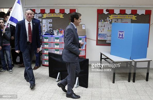 Israeli Labour Party leader and coleader of the Zionist Union list for the upcoming general election Isaac Herzog prepares to cast his ballot at a...