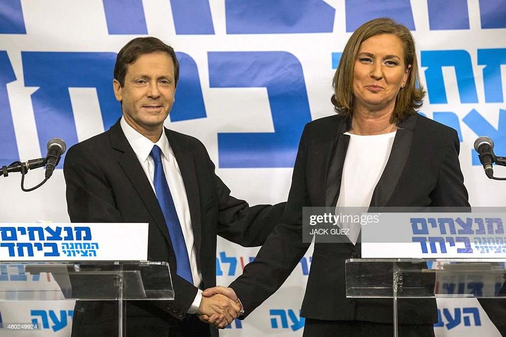 Israeli Labour Party leader Isaac Herzog (L) and former justice minister and HaTnuah party leader <a gi-track='captionPersonalityLinkClicked' href=/galleries/search?phrase=Tzipi+Livni&family=editorial&specificpeople=537394 ng-click='$event.stopPropagation()'>Tzipi Livni</a> shake hands during a press conference in Tel Aviv on December 10, 2014. Hertzog and Livni announced an alliance to contest Israel's snap general election in March, and polls published on Tuesday said an alliance between Labour and Livni's HaTnuah party could nudge Netanyahu's Likud from power.. AFP PHOTO/ JACK GUEZ