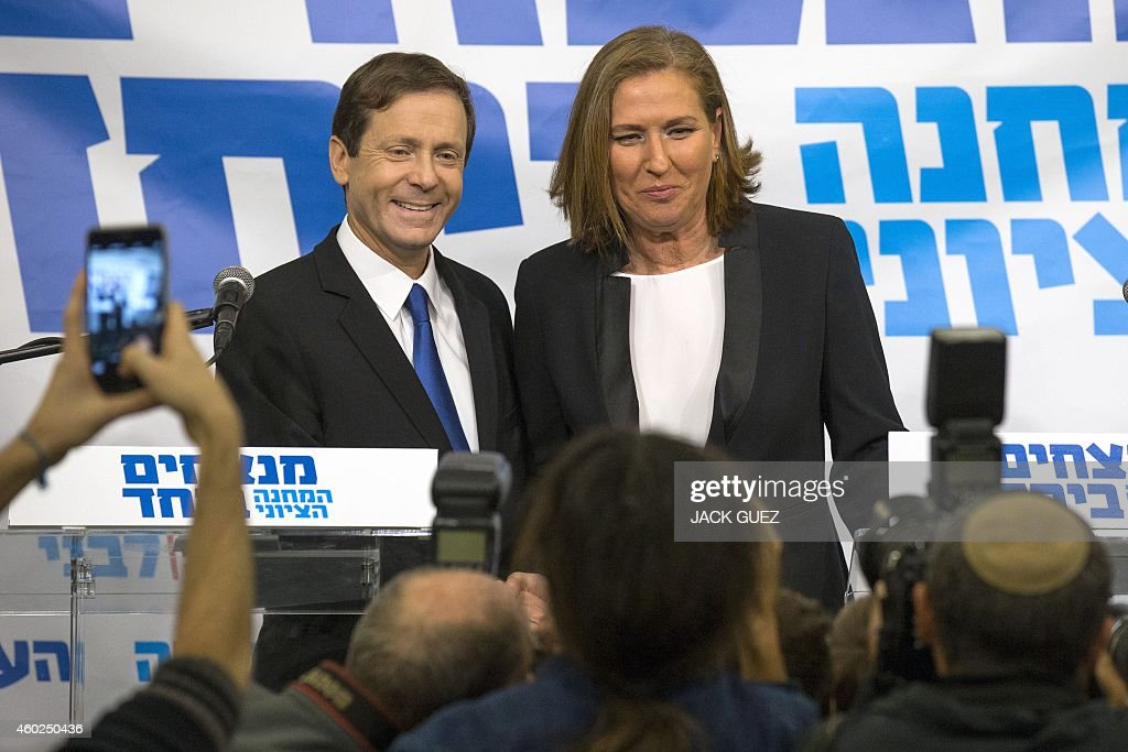 Israeli Labour Party leader Isaac Herzog (L) and former justice minister and HaTnuah party leader <a gi-track='captionPersonalityLinkClicked' href=/galleries/search?phrase=Tzipi+Livni&family=editorial&specificpeople=537394 ng-click='$event.stopPropagation()'>Tzipi Livni</a> pose for photos during a press conference in Tel Aviv on December 10, 2014. Hertzog and Livni announced an alliance to contest Israel's snap general election in March, and polls published on Tuesday said an alliance between Labour and Livni's HaTnuah party could nudge Netanyahu's Likud from power.. AFP PHOTO/ JACK GUEZ