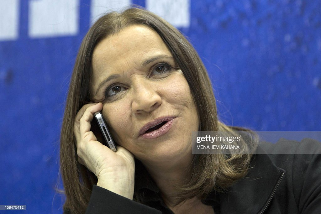 Israeli Labour party's leader Shelly Yachimovich speaks on the phone with supporters as part of her campaign for the general elections for the country's 19th Knesset on January 14, 2013 at a shopping mall in Tel Aviv. Israeli election will be held on January 22. AFP PHOTO/MENAHEM KAHANA