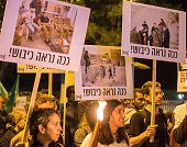 Israeli leftwing activists hold placards during a 'Peace Now' march calling on Israelis to choose ''another way'' and end the occupation of...