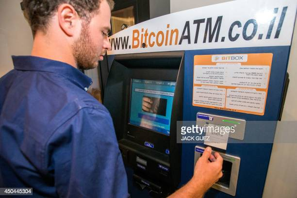 A Israeli man buys Bitcoins at the first Bitcoin ATM machine installed in the Middle East on June 11 2014 at the TownHouse TLV hotel in the...