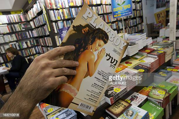 A Israeli man looks at the first Hebrew edition of the iconic men's magazine Playboy in Israel following the magazines debut in the Holy Land at a...