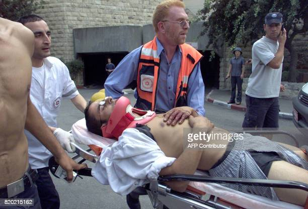 Israeli medics run with a stretcher ferrying an injured man following an explosion at the busy cafeteria in east Jerusalem's Hebrew University 31...