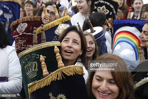 Israeli members of the liberal Jewish religious group Women of the Wall carry a Torah scroll during prayers in the women's section of the Western...