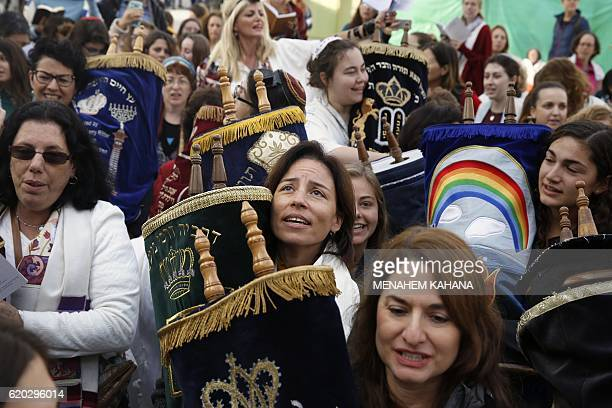 Israeli members of the liberal Jewish religious group Women of the Wall carry a Torah scroll after prayers in the women's section of the Western Wall...