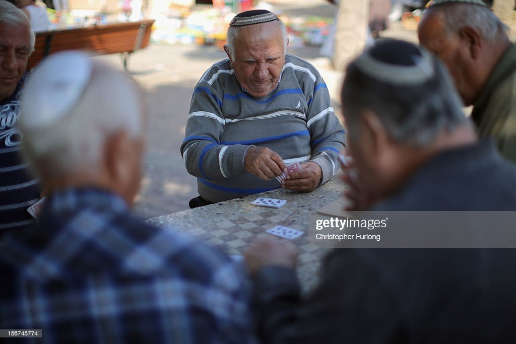 Israeli men play cards during a lull in militant rocket fire on November 20, 2012 in Ashkelon, Israel. Hamas militants and Israel are continuing talks aimed at a ceasefire as the death toll in Gaza reaches over 100 with three Israelis also having been killed by rockets fired by Palestinian militants.