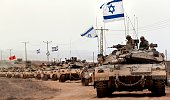 Israeli Merkava tanks drive near the border between Israel and the Gaza Strip as they return from the Hamascontrolled Palestinian coastal enclave on...