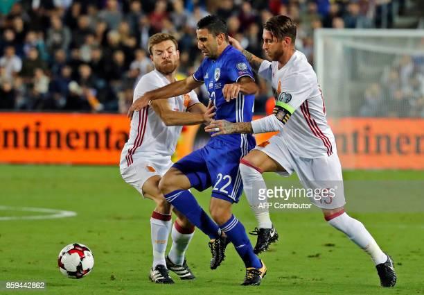 Israeli midfielder Eyal Golasa vies with Spain's midfielder Asier Illarramendi and defender Sergio Ramos during the Russia 2018 FIFA World Cup...