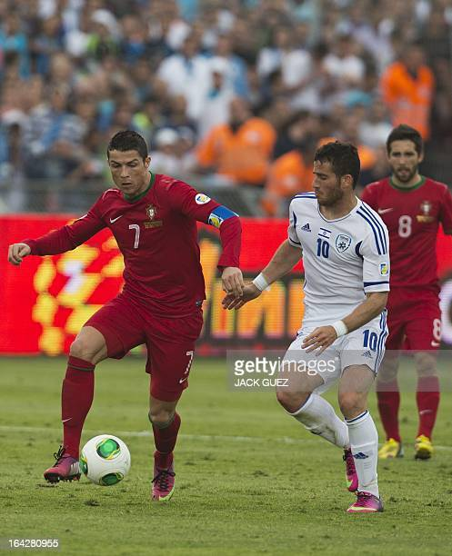 Israeli midfielder Gal alberman vies with Portuguese forward Cristiano Ronaldo during the FIFA 2014 World Cup European zone qualifying group F match...