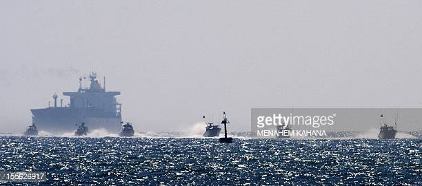 Israeli military boats approach the southern port of Ashdod on May 31 after Israeli navy commandos stormed a Gazabound aid flotilla in international...