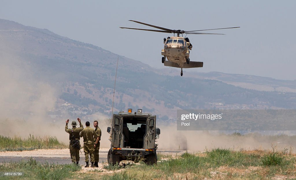 Israeli military personnel guide a UH60 Blackhawk helicopter with US Defense Secretary Ash Carter and Israeli Defense Minister Moshe Ya'alon aboard...