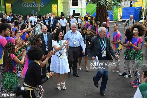 Israeli Minister of Culture and Sport Miri Regev applauds as Israel's Olympic team secretary general Yoram Arnstein dances with performers during a...