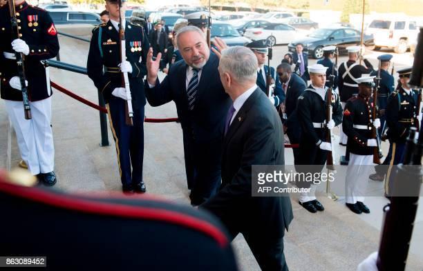 Israeli Minister of Defense Avigdor Lieberman talks with US Secretary of Defense Jim Mattis as they walk through an honor cordon prior to their...
