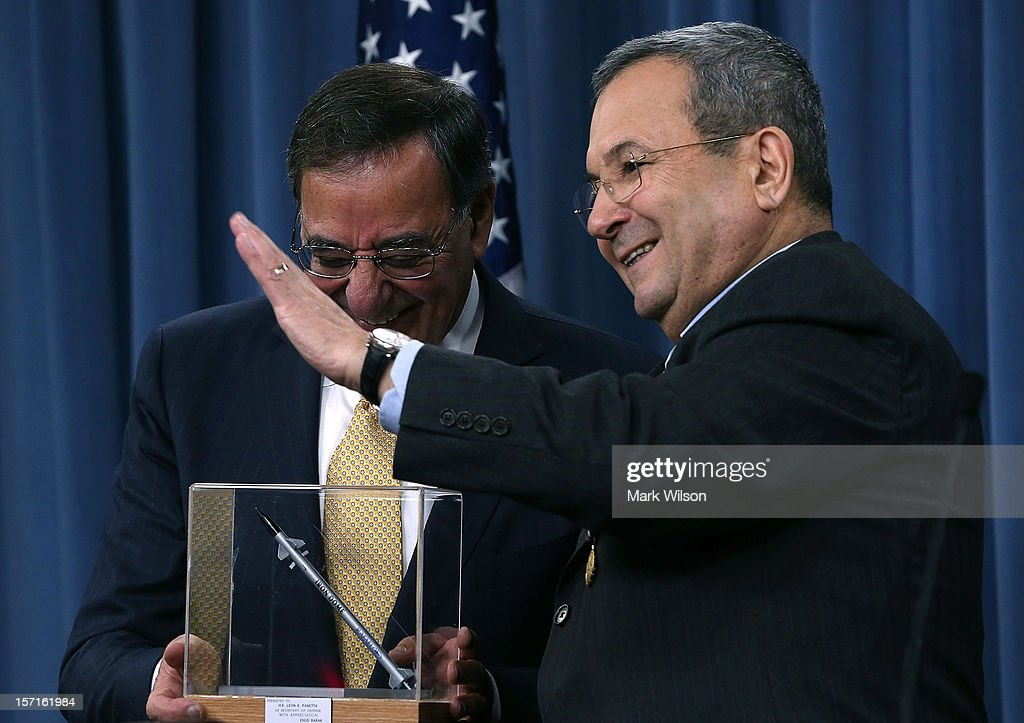 Israeli Minister of Defense Ehud Barak presents Secretary of Defense Leon Panetta with a model of a missile after being presented with the US Medal...