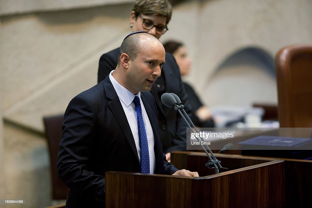 Israeli Minister of Economics and Trade <a gi-track='captionPersonalityLinkClicked' href=/galleries/search?phrase=Naftali+Bennett&family=editorial&specificpeople=6632880 ng-click='$event.stopPropagation()'>Naftali Bennett</a> speaks during a swearing-in ceremony at the Knesset, on March 18, 2013 in Jerusalem, Israel. Israel's 33rd government is to be sworn in today after almost six weeks of negotiations to piece together a coalition government.