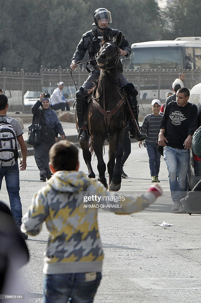 Israeli mounted police disperse Palestinian protestors who threw stones at a police station in Salahaddin street, a main commercial area of mostly Arab east Jerusalem, on November 22, 2012 . The incident followed the detainment of a Palestinian woman who tried to stab an Israeli border policeman. AFP PHOTO / AHMAD GHARABLI