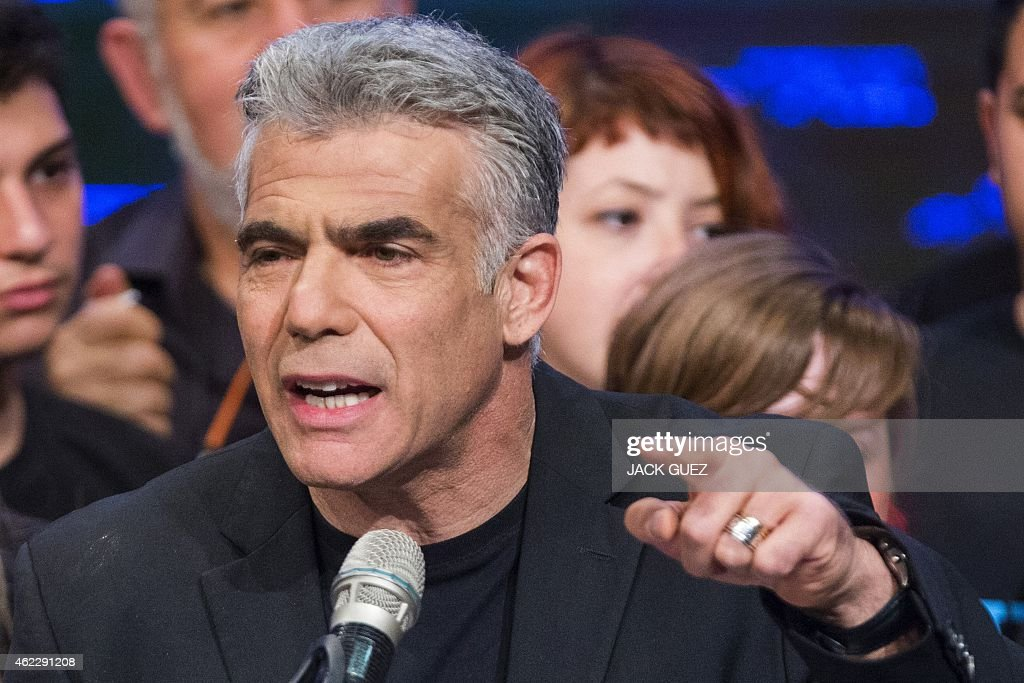 Israeli MP and chairperson of center-right Yesh Atid party, Yair Lapid, delivers a speech outlining the Yesh Atid campaign and presenting the party's list for the 20th Knesset, on January 26, 2015 in the Israeli city of Rishon Letzion, ahead of the March 17 general elections.