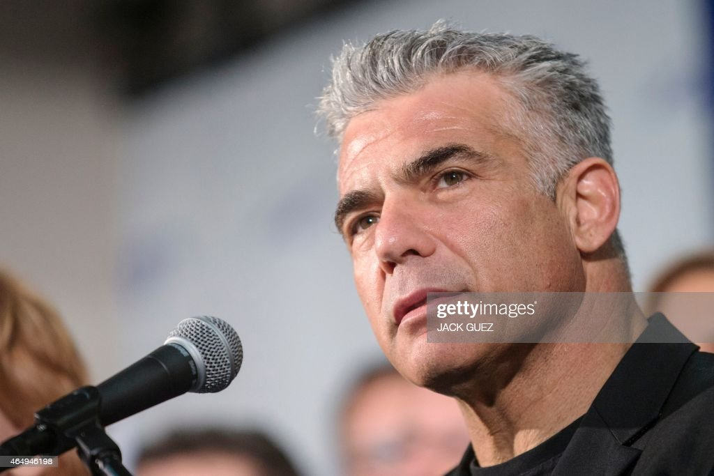 Israeli MP and chairperson of center-right Yesh Atid party, <a gi-track='captionPersonalityLinkClicked' href=/galleries/search?phrase=Yair+Lapid&family=editorial&specificpeople=5366792 ng-click='$event.stopPropagation()'>Yair Lapid</a>, delivers a speech to launch his party's platform during a press conference in the Israeli coastal city of Tel Aviv on March 2, 2015 ahead of the March 17 general elections. AFP PHOTO / JACK GUEZ