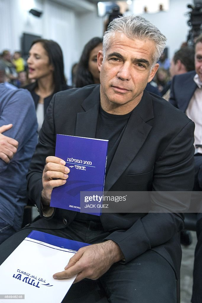 Israeli MP and chairperson of center-right Yesh Atid party, <a gi-track='captionPersonalityLinkClicked' href=/galleries/search?phrase=Yair+Lapid&family=editorial&specificpeople=5366792 ng-click='$event.stopPropagation()'>Yair Lapid</a>, arrives to a press conference in the Israeli coastal city of Tel Aviv to launch his party's platform on March 2, 2015 ahead of the March 17 general elections.